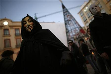 WikiLeaks supporters wear masks of the ''Anonymous'' internet activist group and a mask of WikiLeaks founder Julian Assange (R) during a demonstration calling for the release of Assange, in Malaga, southern Spain December 11, 2010. REUTERS/Jon Nazca