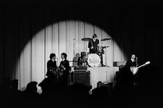 <p>The Beatles perform on stage during their first tour of the U.S. in this photograph taken by Mike Mitchell and auctioned by Christie's in New York on July 20, 2011. REUTERS/Mike Mitchell/Christie's/Handout</p>