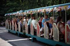 <p>The park train is pictured at the abandoned amusement park Spreepark during a summer party at the park in Berlin July 16, 2011. REUTERS/Fabrizio Bensch</p>