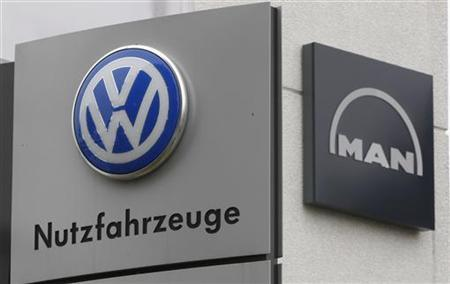 Signs of VW and MAN are pictured at a truck service centre in Dortmund July 4, 2011. REUTERS/Ina Fassbender
