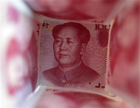 A 100 Yuan note is surrounded by other 100 Yuan notes in this picture illustration in Beijing March 22, 2011. REUTERS/Jason Lee