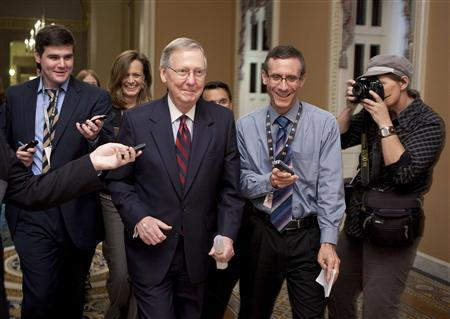 U.S. Senate Minority Leader Mitch McConnell (R-KY) walks to the Senate Chamber after a tentative agreement had been reached on the debt ceiling crises on Capitol Hill in Washington July 31, 2011. REUTERS/Joshua Roberts