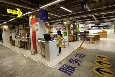 An employee works at a service station at the 11 Furniture Store in  Kunming, southwest China's Yunnan province, July 28, 2011. The store, which  resembles an ...