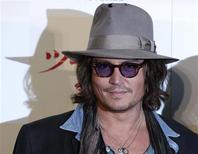 """<p>Actor Johnny Depp poses during a photo session to promote the movie """"The Tourist"""" in Tokyo, in this March 3, 2011 file picture. REUTERS/Toru Hanai/Files</p>"""