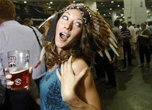 <p>A woman reacts to the camera at the Campaign For Real Ale Great British Beer Festival at Earls Court in London, August 2, 2011. REUTERS/Luke MacGregor</p>