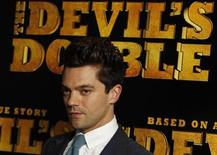 """<p>Actor Dominic Cooper poses for photographers at the British Premiere of """"The Devil's Double"""", in London August 1, 2011. REUTERS/Luke MacGregor</p>"""