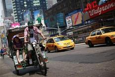 <p>A pedicab rides through New York's Times Square, July 21, 2011. REUTERS/Brendan McDermid</p>