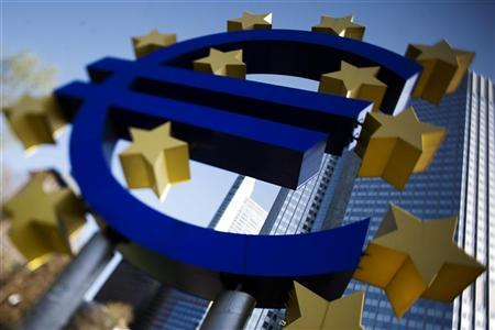 A sculpture showing the Euro currency sign is seen in front of the European Central Bank (ECB) headquarters in Frankfurt April 7, 2011. The picture is taken with a tilt and shift lens. REUTERS/Alex Domanski