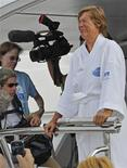 <p>Diana Nyad cries as she speaks to reporters and fans after arriving back in Key West, Florida August 9, 2011. An asthma attack, a painful shoulder and battering wind and waves forced 61-year-old swimmer Diana Nyad to abandon early on Tuesday her bid to become the first person to swim from Cuba to Florida without a shark cage. REUTERS/Rob O'Neal/Florida Keys News Bureau/Handout</p>