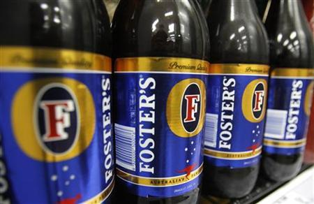 Bottles of Fosters beer are seen in a refrigerator at a liquor store in Melbourne in this February 16, 2010 file photo. REUTERS/Mick Tsikas/Files