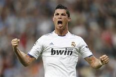 <p>Real Madrid's Cristiano Ronaldo celebrates after scoring a goal against Tottenham Hotspur during their Champions League quarter-final soccer match at Santiago Bernabeu stadium in Madrid, in this April 5, 2011 file picture. REUTERS/J. Sanchez/Files</p>
