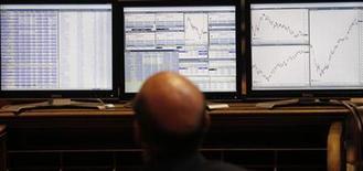 <p>A trader looks at screens at the Madrid bourse August 12, 2011. REUTERS/Juan Medina</p>