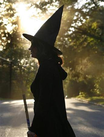 A woman dressed as a witch walks along the street during Halloween celebrations in Port Washington, New York, October 31, 2007. REUTERS/Shannon Stapleton