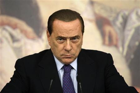 Italian Prime Minister Silvio Berlusconi attends a news conference at Chigi palace in Rome August 12, 2011. REUTERS/Remo Casilli