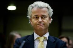 <p>Dutch right-wing politician Geert Wilders of the Freedom Party listen in the courtroom in Amsterdam June 23, 2011. REUTERS/POOL/Robin Utrecht</p>