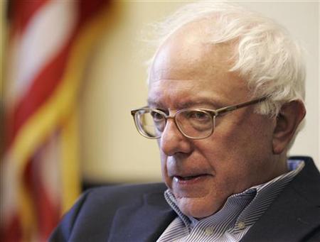 Senator Bernie Sanders (I-VT) is interviewed by a Reuters reporter at Sanders' office in Burlington, Vermont November 28, 2006. REUTERS/Brian Snyder