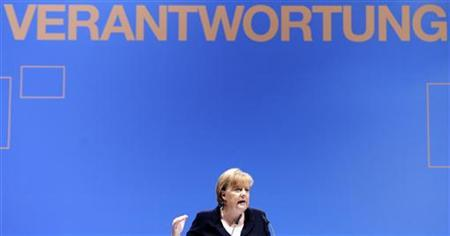 German Chancellor and leader of the Christian Democratic Party (CDU) Angela Merkel, gestures as she delivers her speech at a party meeting of Lower Saxony's CDU in Hameln, August 19, 2011. Slogan is reading: ''Responsibility''. REUTERS/Fabian Bimmer
