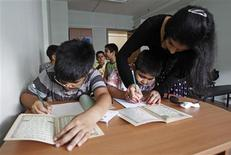 <p>Afghan schoolchildren learn Dari and Pashto languages at a classroom in the Sevastopol hotel in southern Moscow, July 30, 2011. REUTERS/Sergei Karpukhin</p>