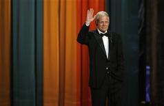 """<p>Late night television host David Letterman waves to the crowd as he accepts The Johnny Carson Award for Comedic Excellence at """"The Comedy Awards"""" in New York City March 26, 2011. REUTERS/Jessica Rinaldi</p>"""