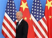 <p>U.S. Vice-President Joe Biden arrives with his Chinese counterpart Xi Jinping (not pictured) at a China-US Business Dialogue in the Beijing Hotel in Beijing August 19, 2011. REUTERS/How Hwee Young/Pool</p>