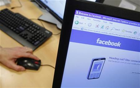 A Facebook page is displayed on a computer screen in Brussels in this April 21, 2010 file photo. REUTERS/Thierry Roge