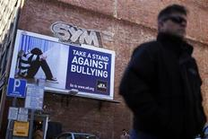 <p>A pedestrian walks past an anti-bullying billboard in downtown Boston, Massachusetts March 3, 2011. REUTERS/Brian Snyder</p>