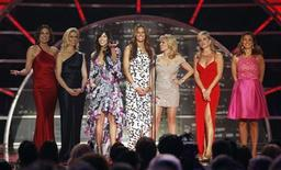 "<p>The cast of ""The Real Housewives of New York City"" present an award during the 2011 TV Land Awards in New York April 10, 2011. REUTERS/Lucas Jackson</p>"