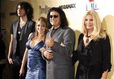 "<p>Gene Simmons, star of the film ""Extract"", gestures as he poses at the film's premiere with his partner Shannon Tweed (R), their daughter Sophie Simmons (2nd L) and son Nick Tweed-Simmons (L) in Hollywood, California August 24, 2009. REUTERS/Fred Prouser</p>"
