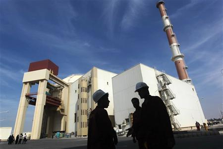 Iranian workers stand in front of the Bushehr nuclear power plant, about 1,200 km (746 miles) south of Tehran, in this October 26, 2010 file picture. REUTERS/Mehr News Agency/Majid Asgaripour/Files