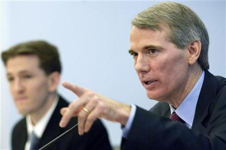 Rob Portman (R) testifies next to an unidentified aide before the House Budget Committee on Capitol Hill in Washington February 6, 2007. REUTERS/Jonathan Ernst
