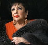 <p>Elizabeth Taylor arrives for a play in Los Angeles in this December 1, 2007 file photo. Taylor has been admitted to a Los Angeles hospital to treat symptoms from congestive heart failure, her spokeswoman said February 11, 2011. REUTERS/Mario Anzuoni/Files</p>