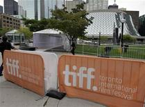<p>Workers prepare the red carpet area at Roy Thomson Hall for the start of the 36th Toronto International Film Festival in Toronto September 7, 2011. REUTERS/Mike Cassese</p>