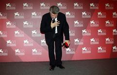 """<p>Alexander Sokurov, director of """"Faust"""", bows after receiving the Golden Lion award during the closing ceremony of the 68th Venice Film Festival September 10, 2011. REUTERS/Eric Gaillard</p>"""