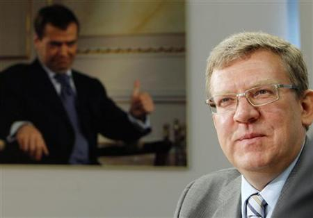 Russia's Finance Minister Alexei Kudrin attends the Reuters Russia Investment Summit, with a photo of President Dmitry Medvedev seen in the background, in Moscow September 13, 2011. REUTERS/Denis Sinyakov