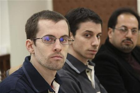American hikers Shane Bauer (L) and Josh Fattal (C) and their translator attend the first session of their trial at the revolutionary court in Tehran February 6, 2011. REUTERS/PRESS TV