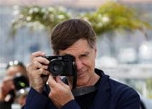 """<p>Director Gus Van Sant takes pictures during a photocall for the film """"Restless"""" in competition for the category """"Un Certain Regard"""" at the 64th Cannes Film Festival May 13, 2011. REUTERS/Yves Herman</p>"""