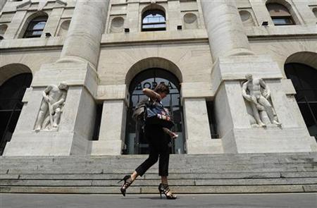 A woman walks past Milan Stock Exchange July 12, 2011. REUTERS/Paolo Bona
