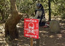 <p>Biruntha Ravichandran, 21, a deminer working for the Swiss Foundation for Mine Action (FSD), searches for mines in a mine field in Kannaddi, located in Mannar district in Sri Lanka, September 8, 2011. REUTERS/ALERTNET/Nita Bhalla</p>