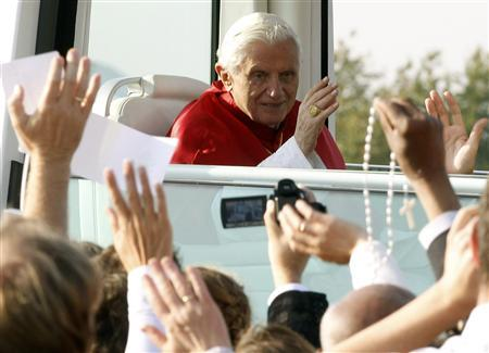 Pope Benedict XVI waves from the Popemobile after celebrating the Eucharist in the southwest German town of Freiburg, September 25, 2011. REUTERS/Arnd Wiegmann