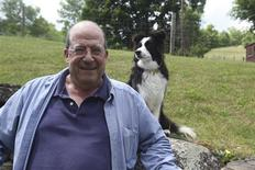 <p>Author Jon Katz poses for a picture with a dog in this publicity photo released to Reuters September 23, 2011. REUTERS/Maria Will/Handout</p>