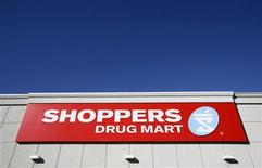 <p>A sign is pictured outside a Shoppers Drug Mart in Ottawa November 10, 2010. REUTERS/Chris Wattie</p>