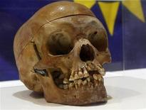 <p>A human skull from the Herero and ethnic Nama people is displayed during a ceremony in the auditorium of Berlin's Charite hospital September 30, 2011. REUTERS/Tobias Schwarz</p>