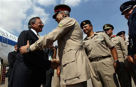 U.S. Defense Secretary Leon Panetta (L) is greeted by Egyptian Major General Rouini as he arrives in Cairo October 4, 2011. REUTERS/Win McNamee/Pool