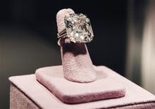 <p>A 33.19 carats diamond ring given to Elizabeth Taylor by her fifth husband Richard Burton is pictured at the press preview for Christie's auction of The Collection of Elizabeth Taylor featuring her jewelry, haute couture, fashion, and fine arts at MOCA Pacific Desgin Center in Los Angeles October 10, 2011. The diamond is expected to bring $2.5 to $3.5 million at the auction beginning December 13 in New York. REUTERS/Fred Prouser</p>