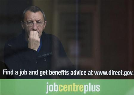 A man looks from the window of a job centre in Leicester, central England September 14, 2011. REUTERS/Darren Staples