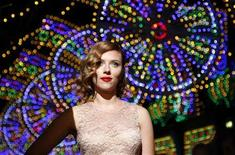 <p>Actress Scarlett Johansson poses for photographers on the catwalk before the Dolce & Gabbana Spring/Summer 2012 women's collection during Milan Fashion Week September 25, 2011. REUTERS/Alessandro Garofalo</p>