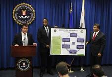 """<p>FBI Cyber Supervisor Agent Cameron Malin (L) speaks about the anatomy of a computer hack as U.S. Attorney Andre Birotte Jr.(C) and Assistant Director in Charge of FBI's Los Angeles Field Office Steven Martinez (R) hold a descriptive chart during an announcement of the arrest of Christopher Chaney, 35, of Jacksonville, Florida, in operation """"Hackerazzi"""" for targeting celebrities with computer intrusion, wiretapping and identity theft, at the Federal Building in Los Angeles October 12, 2011. REUTERS/Danny Moloshok</p>"""