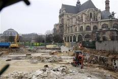 """<p>A view shows heavy construction equipment working at the destruction of the """"Forum des Halles"""" complex near Saint Eustache church in Paris March 17, 2011. REUTERS/Jacky Naegelen</p>"""