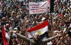<p>Protesters chant slogans against the government and military rulers at Tahrir Square after Friday prayers in Cairo October 7, 2011. REUTERS/Mohamed Abd El-Ghany</p>