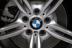 <p>A BMW logo is seen on a displayed car on media day at the Paris Mondial de l'Automobile October 1, 2010. REUTERS/Jacky Naegelen</p>